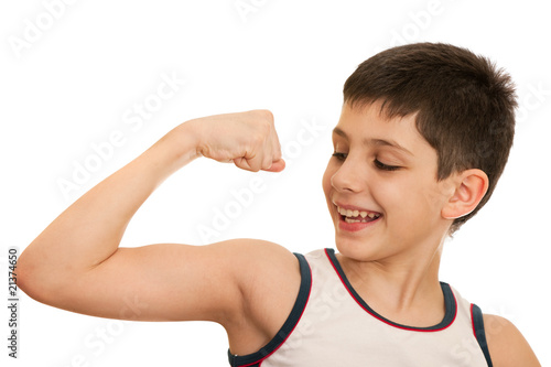 Boy demonstrates results of his exercises