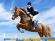 Leinwandbild Motiv Equestrian jumper - Young girl jumping with sorrel horse