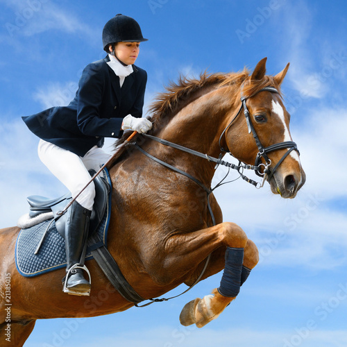 Equestrian jumper - Young girl jumping with sorrel horse