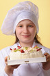 Young chef and a cake