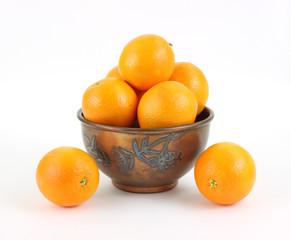 Naval oranges in vintage metal bowl