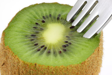 Close view of Kiwi fruit with fork