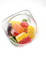 delicious sweet candies in sugar in a glass jar