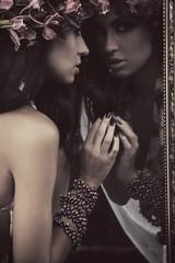 Brunette beauty in a mirror