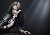 Rock-star woman holding a knife