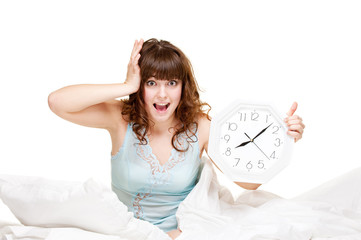 young woman with clock in panic