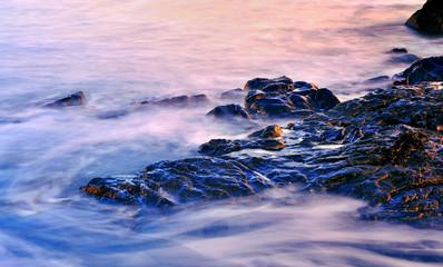 Maine Coast rocks at sunset