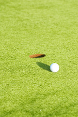 Closeup of a ball on a golf course