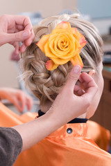 Hairstyle handmade with rose