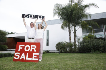 Happy senior couple selling a house