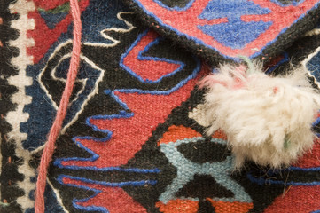 detail macro of hand made knitted turkish kiilm handbag