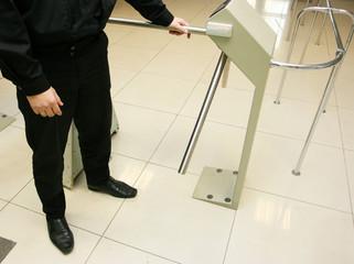 Security officer at a turnstile