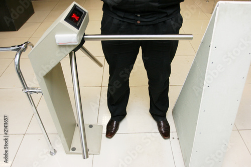 Security officer at a turnstile