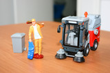 Scale models of a caretaker and a cleaner machine