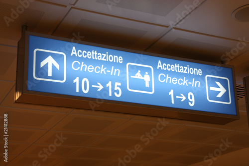 Airport sign in English and Italian language