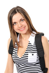 Pretty young female student with a backpack, smiles