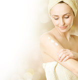Beautiful Young Woman applying moisturizer.Skincare concept poster