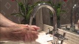 Washing hands in sink hygiene concept