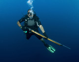 scuba diver with spear gun poster