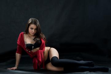 Sexy brunette woman in black lingerie