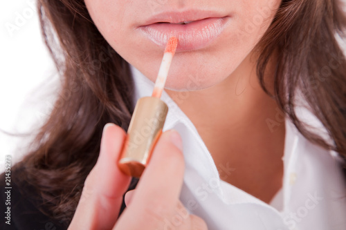 Business woman doing make-up