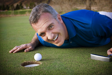 Male Golfer missing the putt