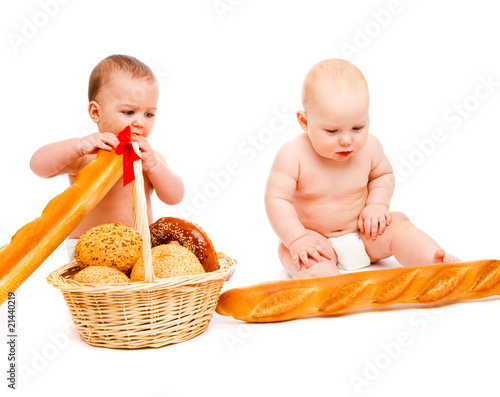 Babies eating bread