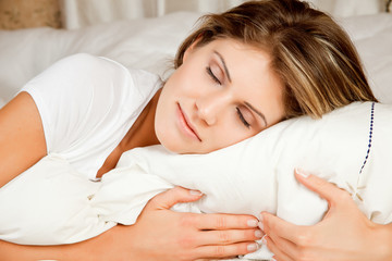 Young beauty woman couch in the bed and sleeping