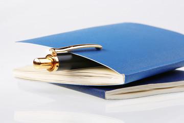 Pen in notebook.