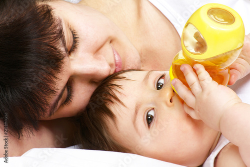 young mother feeding baby with a bottle