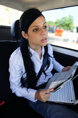 business travel: businesswoman in taxi