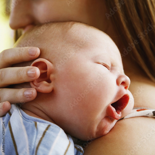 Infant Sleeping on Mother's Shoulder
