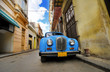 Old car in colorful Havana street