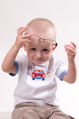 Infant playing with glasses