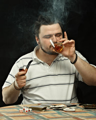 Smoking Gambler with whisky bottle and glass