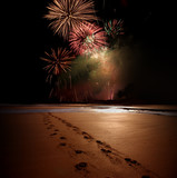 Night time celebration with prints in the sand