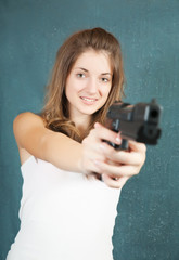 teen girl aiming a gun