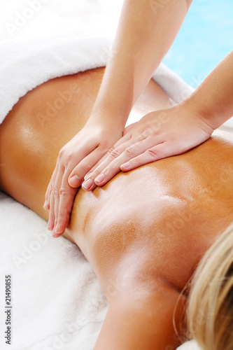 Massage Techniques I - woman receiving professional massage.