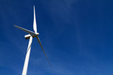 Wind turbine on clear blue sky