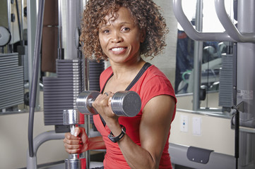 Woman using dumbells
