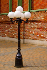 Antique Style Street Lamp in front of Brick Wall