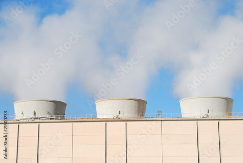 Chimney with smoke in a geothermal power plant in Larderello