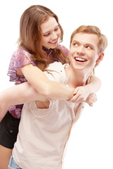 Laughing girl astride young man