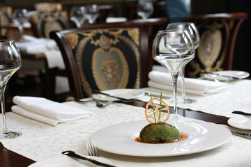 Vegetarian creative food in luxurious restaurant interior
