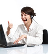 joyful woman operator with headset showing OK
