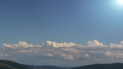 Clouds above mountain time lapse