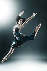 Stylish and young modern style dancer is jumping
