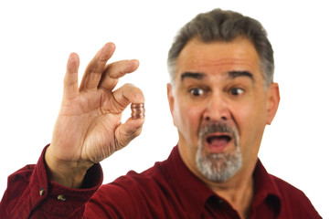 Man holding coins with look of shock on his face