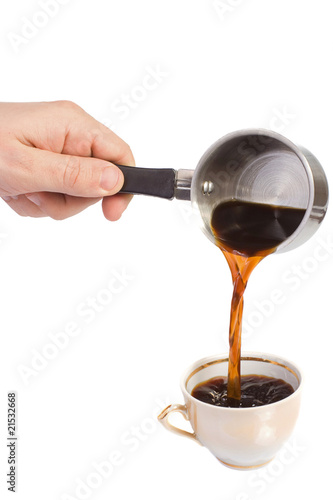 hand holding coffee pot