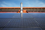 black high performing solar modules and stainless steel chimney poster